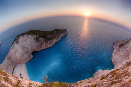 Navagio Bay at sunset in Zakynthos, Greece photo