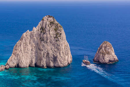 Keri Caves and Clifs in Zakinthos Island, Greece with ship sailing nearby