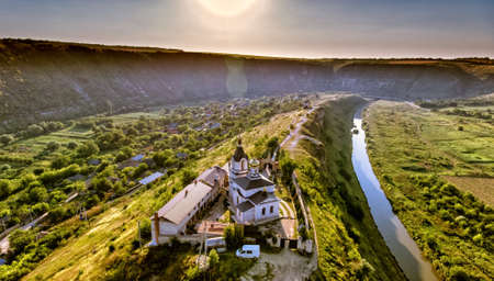 Christian Orthodox church in Old Orhei, Moldova. Aerial view from a drone at sunset.