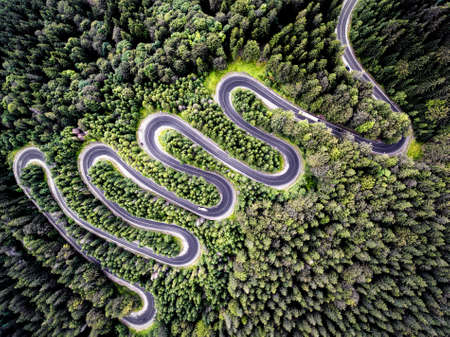 Drone view of a curvy road in Romania 스톡 콘텐츠