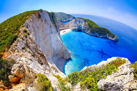 clear waters: Zakynthos shipwreck beach. Navagio Bay panorama with no boats and clear waters. Touristic attraction. Stock Photo