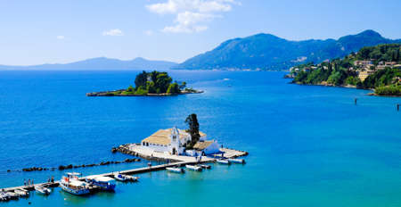 Corfu symbol Pontikonisi island and Vlacherna Monastery as seen from above. Kerkyra island also known as Corfu Greece Фото со стока