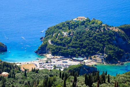 paleokastritsa: Paleokastritsa beach and bay view from above. Important tourist attraction in Corfu island