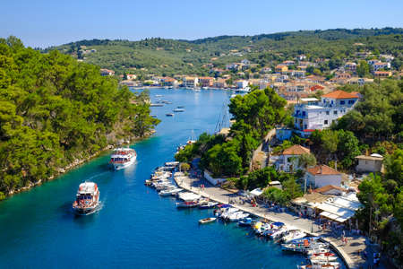 Paxos island with boat entering the grand canal