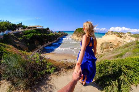 Couple holding hands at Canal D'Amour, Corfu island, Greece