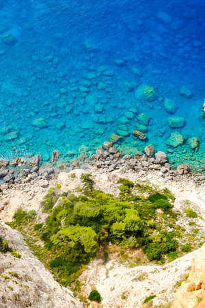 blue waters: Rocky beach with clear blue waters on the island Zakynthos, Greece Stock Photo