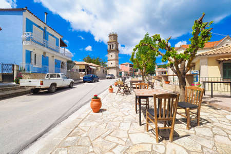 taverna: Traditional Greek Village on the island of Zakynthos with table and chairs in front of a taverna in western greece