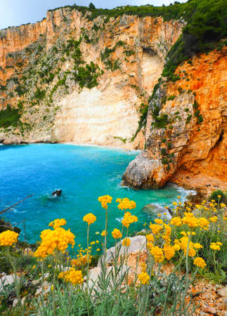 Greek hidden beach in Zakynthos with iconic blue waters and summer sky. Stock Photo