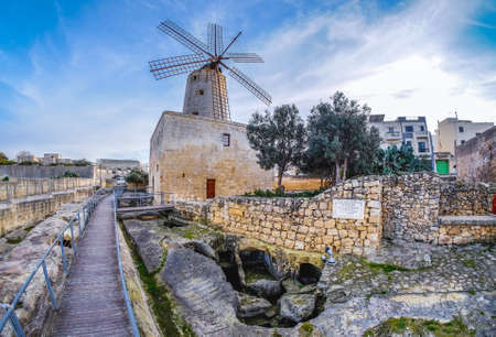 traditional windmill: Old traditional windmill in Malta. Now an important tourist attraction. Abandoned structure. Stock Photo