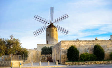 Old traditional windmill in Malta. Now an important tourist attraction. Abandoned structure. Stock Photo