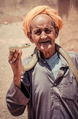 charmer: MARRAKECH, MOROCCO, JUNE 2016: snake charmer on djemaa el fna Editorial