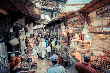 street vendor: FEZ, MOROCCO, JUNE 2016: traditional shop in the old market. Street vendor in the old medina Editorial