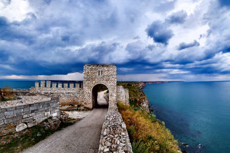 Cape Kaliakra fortress, Bulgaria, dramatic storm comming at Black Sea. Old abandoned fortress by the sea. Important trousitic attraction. Stock Photo