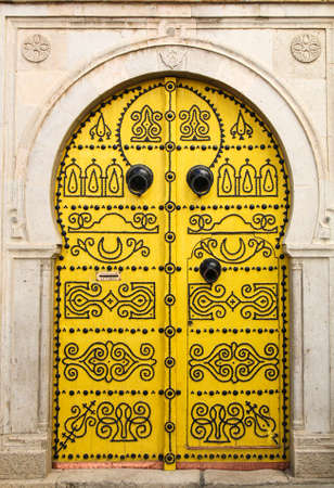 Traditional Tunisian door in Tunis, the capital of the islamic country.