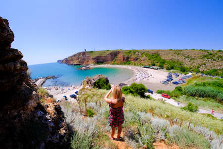 bulgaria girl: Tourist taking pictures at Bolata bay, Bulgaria, Black Sea. Famous beach near Cape Kaliakra. Important tourist attraction.