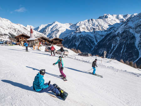 People skiing and snoboarding in Tirol, Austria