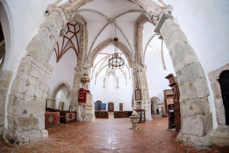 Interior of Prejmer fortified Church. UNESCO heritage site. Reklamní fotografie - 83377909