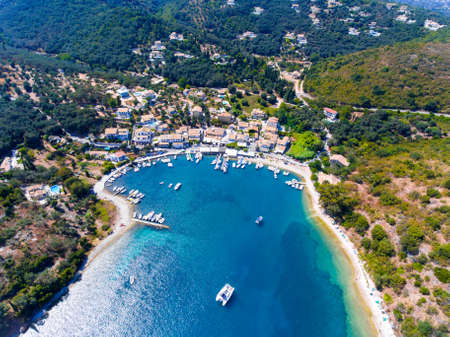 Agios Stefanos bay, one of the most beautiful fishing villages in Corfu Island. Kerkyra, Greece. Aerial view.