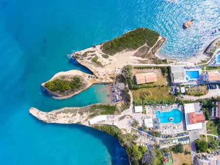 Canal DAmour beach in Sidari, Corfu island, Greece. People bathing in the sun. Turqoise water. Stock Photo