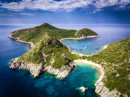 Porto Timoni, on of the hidden beaches of Corfu Island, also known as Kerkyra, near Agios Giorgios beach. Turqoise waters, summer aerial view from drone. Stock Photo