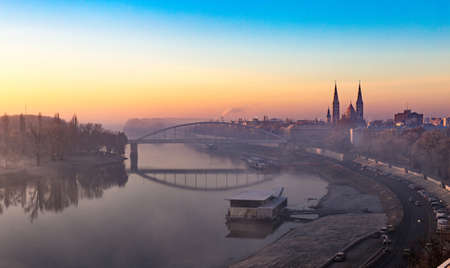 Szeget Hungary at sunset. Votive church and Tisza River visible. Stock Photo