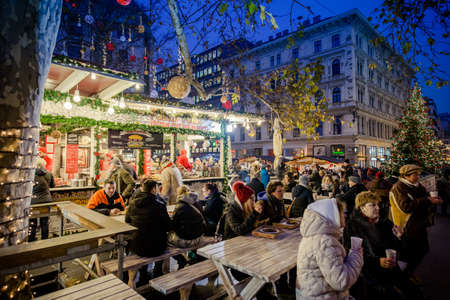 BUDAPEST, HUNGARY - 8 DECEMBER 2016: Tourists enjoy the Christmas market at Vorosmarty Platz in the city center in Budapest, Hungary, Europe