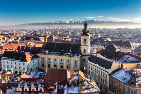 Sibiu, in the center of Transylvania, Romania. View from above with the Fagaras Mountains in the back. HDR photo. City also known as Hermannstadt Stock Photo