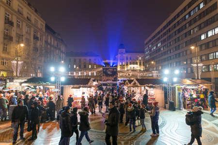 stephen: BUDAPEST, HUNGARY - 8 DECEMBER 2016: Tourists enjoy the Christmas market at Vorosmarty Platz in the city center in Budapest, Hungary, Europe