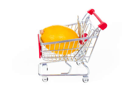 Lemon in shopping cart isolated on white background Stock Photo