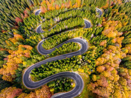 Aerial View of a Winding Road in the Mountains in Autumn Stock Photo