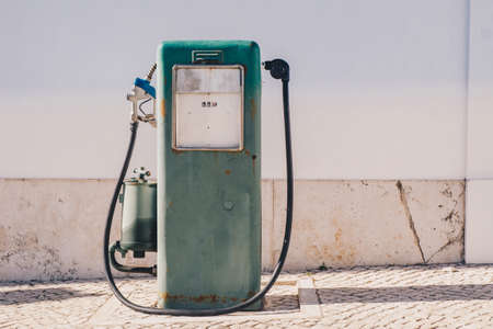Vintage old gasoline pump and oil dispenser