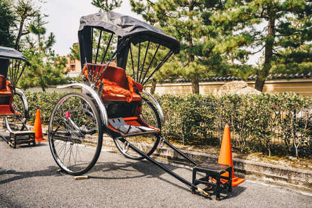 The Rickshaw, a two wheeled human powered taxi in Kyoto, Japan, Asia