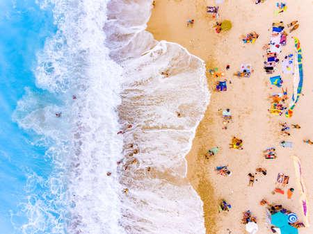 Tourists at the beach bird's eye view Foto de archivo
