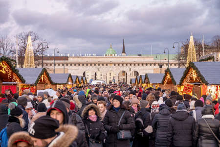 Vienna, Austria - December 2017: crowded christma market in front of the Hofburg