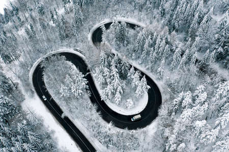 Winter highway trough a fostes aerial view from a drone