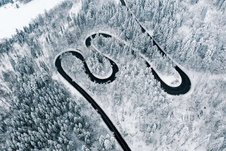 Severe winter weather on roads trough the mountain passes of the Carpathian Mountains Stock Photo
