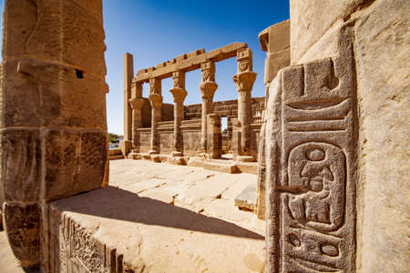 Egyptian heritage hieroglyphs at Philae Temple Aswan. Focus on the hieroglyphs