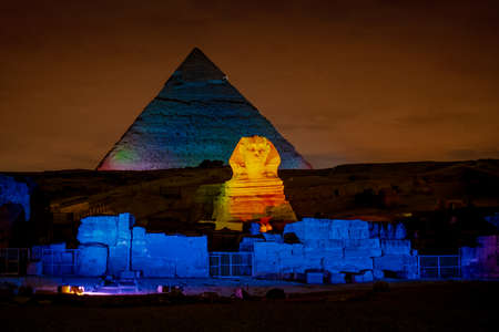 Egypt night at the Pyramids with the Sphinx iluminated in Giza Plateau Cairo