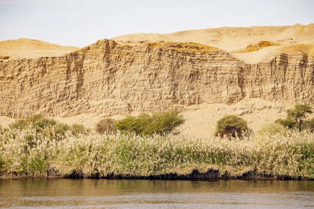 River Nile banks and vegetation and the Sahara Desert starting nearby Stok Fotoğraf