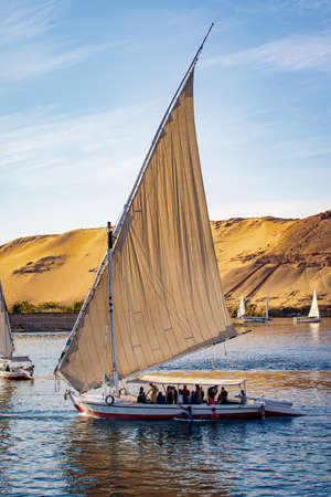 Tourists in a Felucca boat on the Nile River in Luxor Thebes