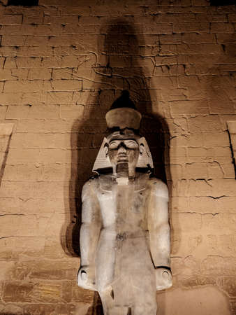 Ramses II or Ramses the Great granite statue at Luxor Temple Thebes in Egypt illuminated at night Stock Photo