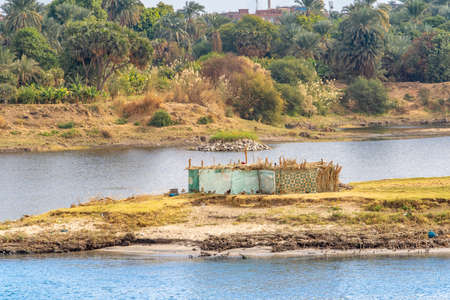 Life on the Nile River. Traditional Egyptian settlement on the banks of the River Nile Stock Photo