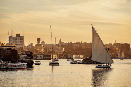 Sunset on Nile River with traditional boats at Luxor Thebes Egypt Stock Photo