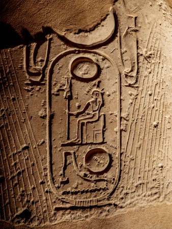 Ancient hieroglyphs depicting pharaohs name on a column at Luxor Temple in Egypt