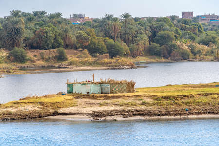 Life on the Nile River. Traditional Egyptian settlement on the banks of the River Nile Stok Fotoğraf