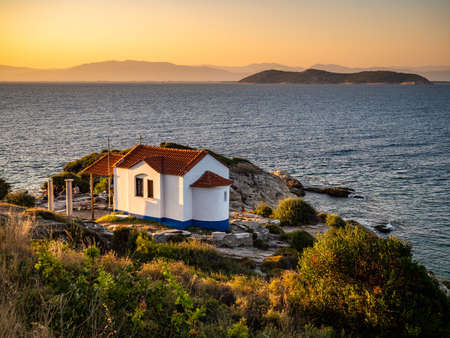 Thasos, Greece, beautiful view at sunset overlooking the sea with a small church visible in the front