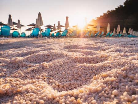 White marble sand detail at Porto Vathy Marble Beach on the Island of Thasos, Greece