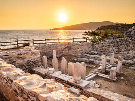 Ancient ruins at Aliki marble quarry in sunrise light, Thassos, Greece. Lens flare visible