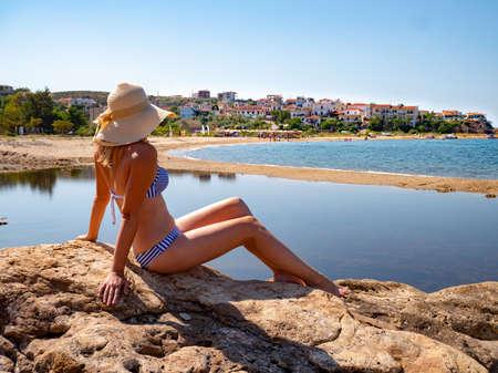 Woman enjoying the sun at the beach on Platanes Beach, Thasos