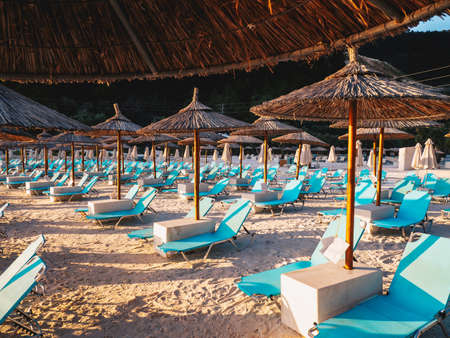 Chairs and umbrellas at Porto Vathy Marble Beach in Thasos, Greece